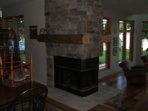 3 sided fireplace of cultured stone