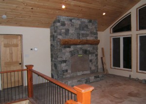 The fireplace with granite stone veneer from a different angle