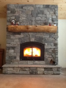 Granite stone veneer on wood burning fireplace