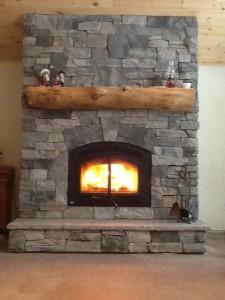 Granite stone veneer on wood burning fireplace