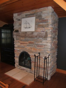 A refaced brick fireplaces with stone veneer