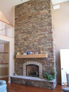 A stunning cultured stone veneer fireplace built with no special floor reinforcement