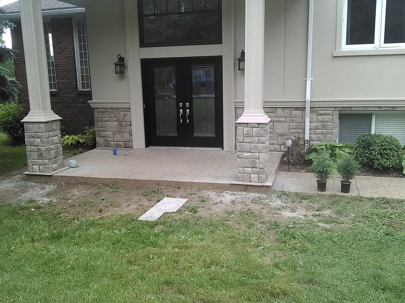 Stonerox cultured stone on front entrance pillars