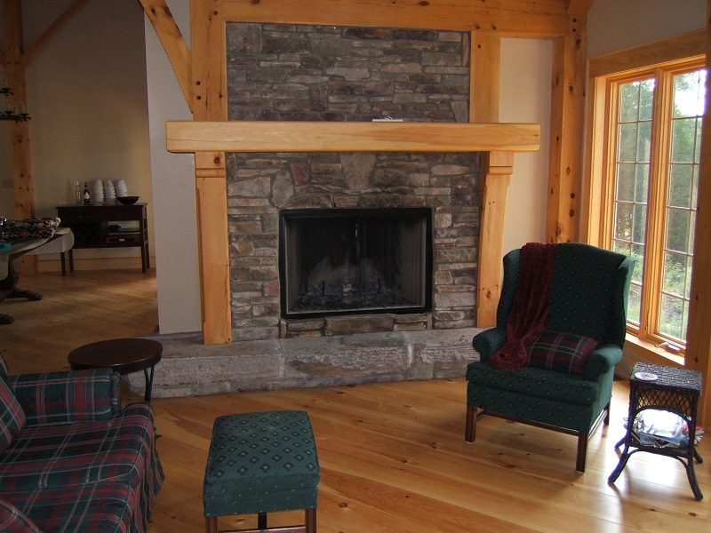 Blend of southern ledge stone with 20 percent field stone on fireplace in post and beam home in Parry Sound.