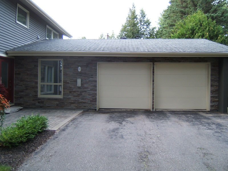 Garage view of home with Pro-Fit Alpine Cultured Stone Ledge Stone.