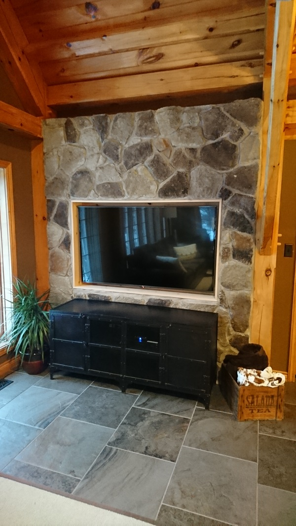 Canyon Stone veneer on accent wall with inset TV.