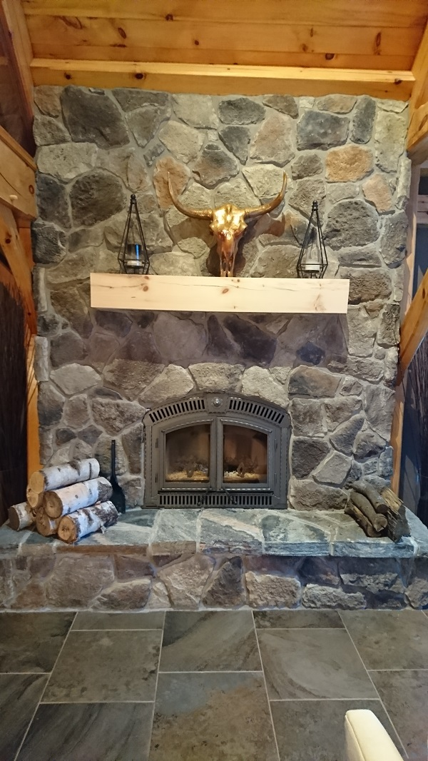 Stone veneer fireplace in Horseshoe Valley home