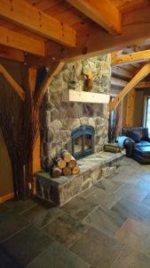 Stone veneer on wood burning fireplace.