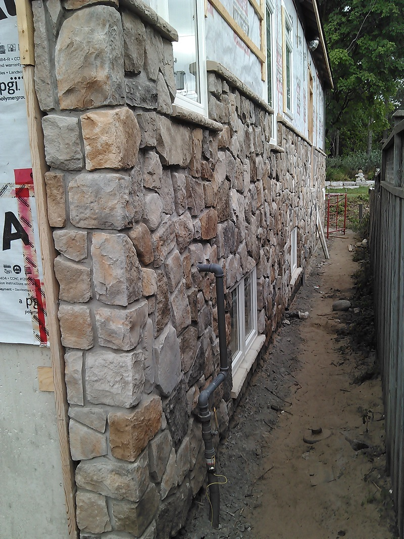 Aspen cultured stone on exterior wall of craftsman style home.