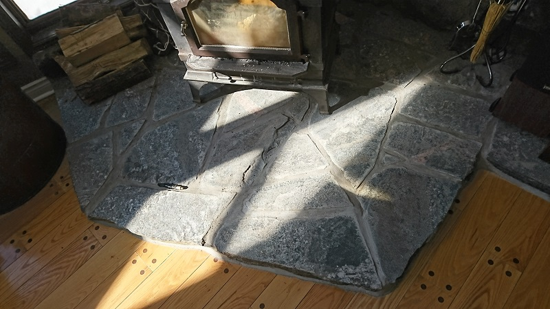 Granite hearth as base for wood stove.