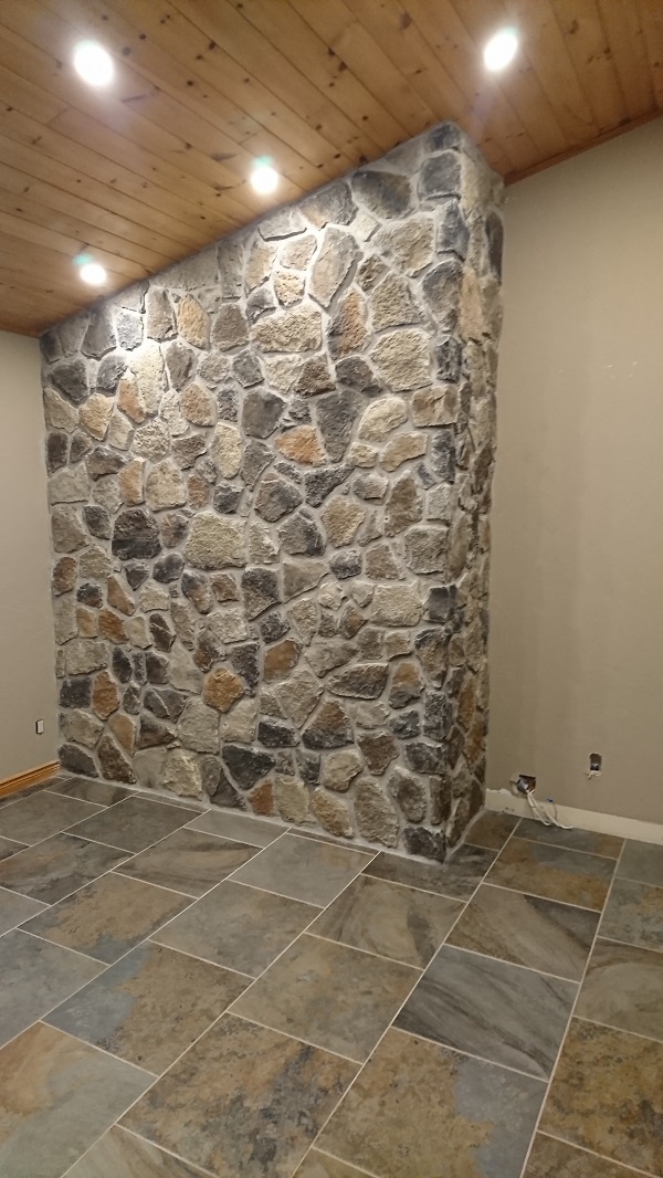Back of fireplace containing driftwood field stone stone veneer by Canyon stone.