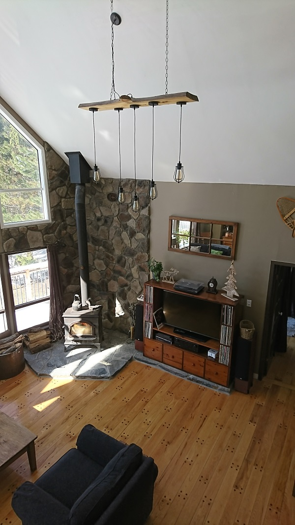 Wood Stove With Stone Veneer Wall Featuring Driftwood