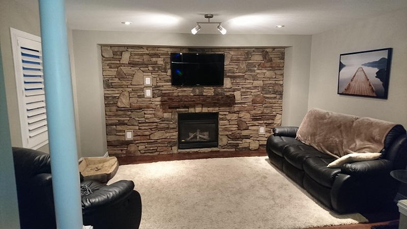 Living room stone veneer accent wall.