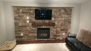 Living room wall with cultured stone veneer.
