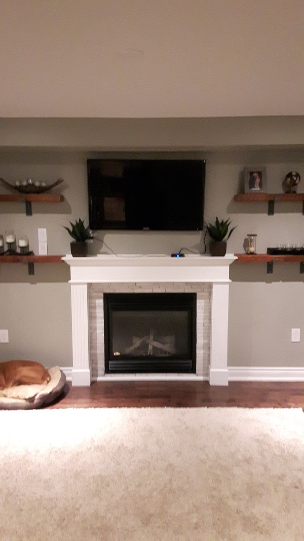 Living room wall with fireplace before addition of stone veneer.