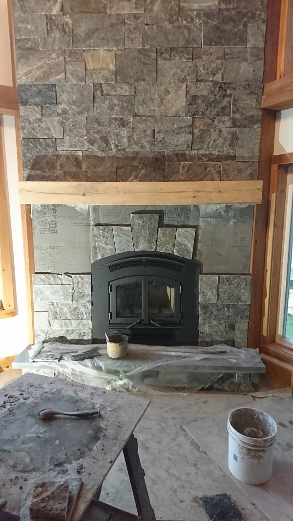 Granite veneer being applied to cement board.