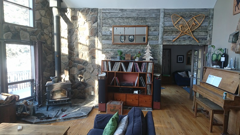 Stone veneer and barn board accent wall.