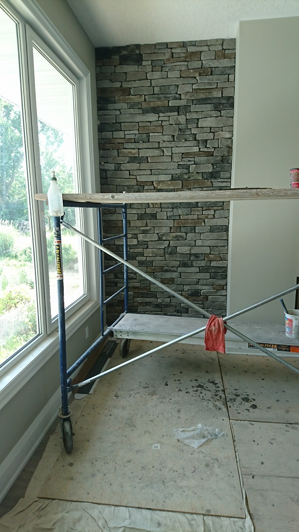 Dry stacked Pennsylvania ledge stone on accent wall.
