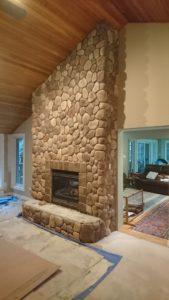 Dutch Quality stone veneer over brick fireplace.