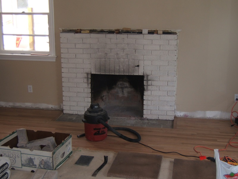 Painted brick fireplace before the addition of stone veneer.