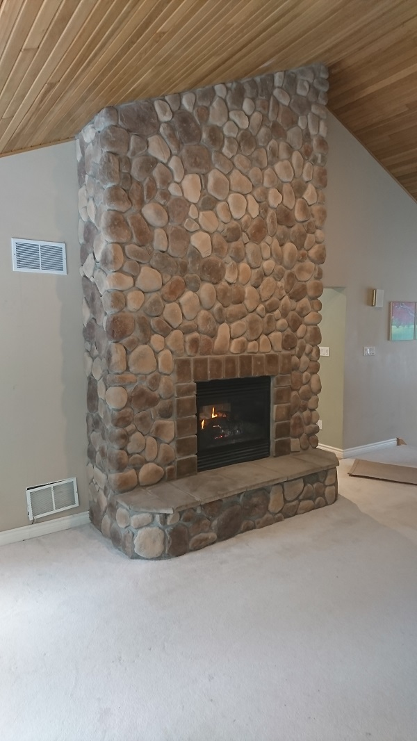 Fog coloured hearth and trim stones compliment the River Rock.