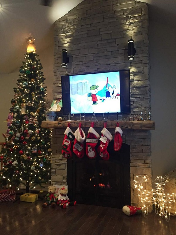 Completed fireplace decorated for Christmas.