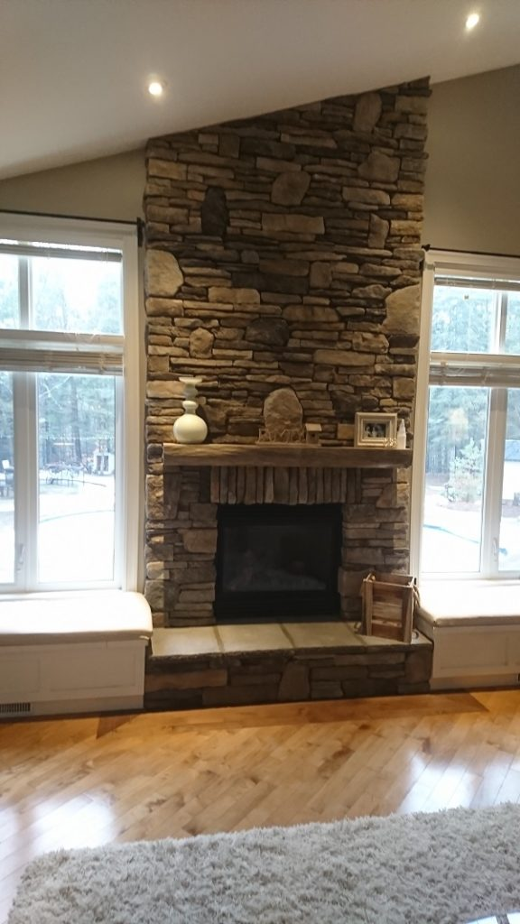 Dry stack stone veneer fireplace.
