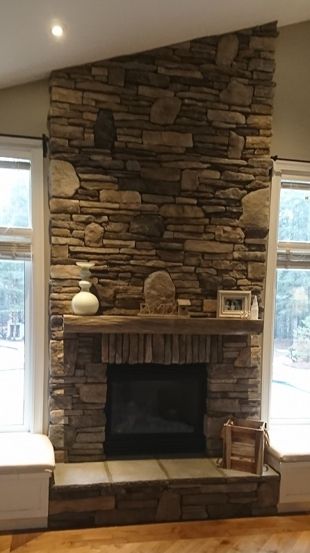 Dry stacked stone blend on fireplace