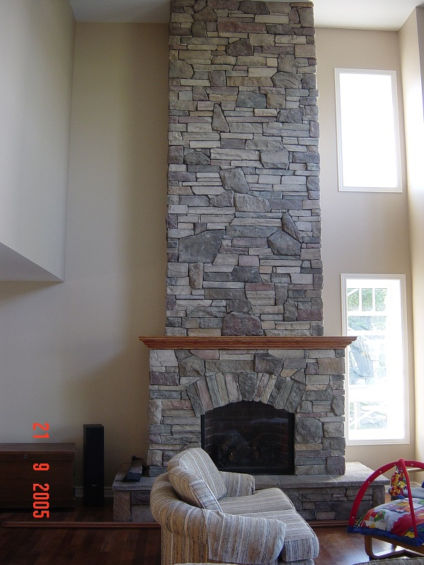 Blended stone veneer textures on an interior fireplace