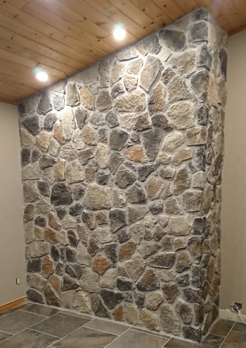 Fieldstone with grouting cut back to reveal the outline of the stone