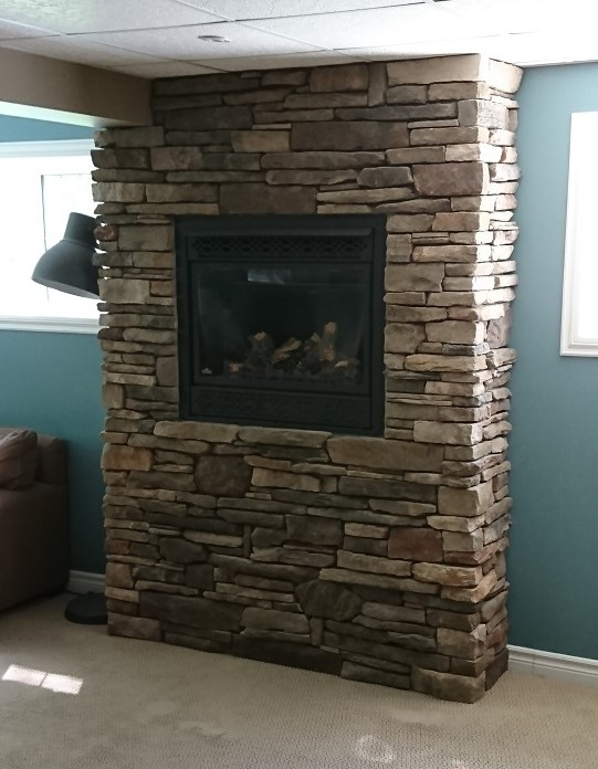 Dry stack stone on gas fireplace