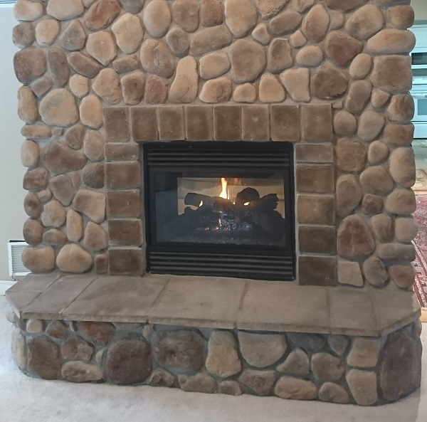Brick fireplace with cultured stone makeover