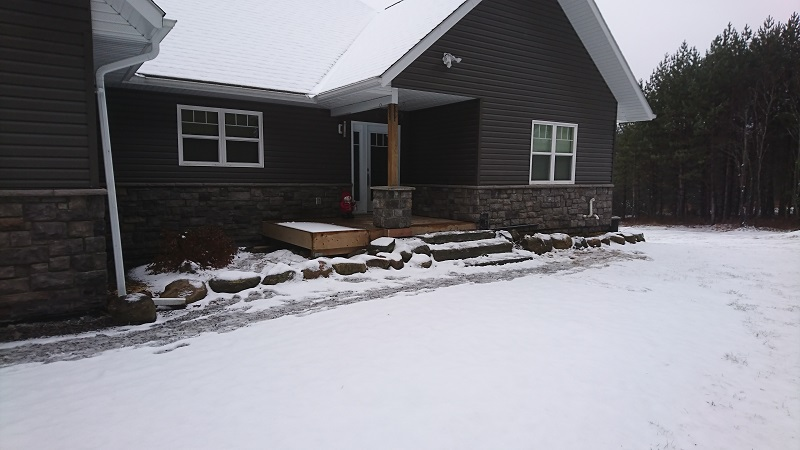 Stone veneer wainscot added to a cottage