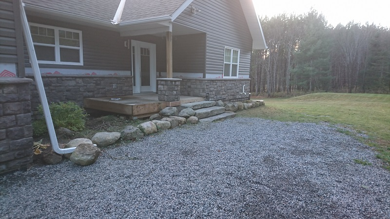 Vinyl siding removed to add cultured stone
